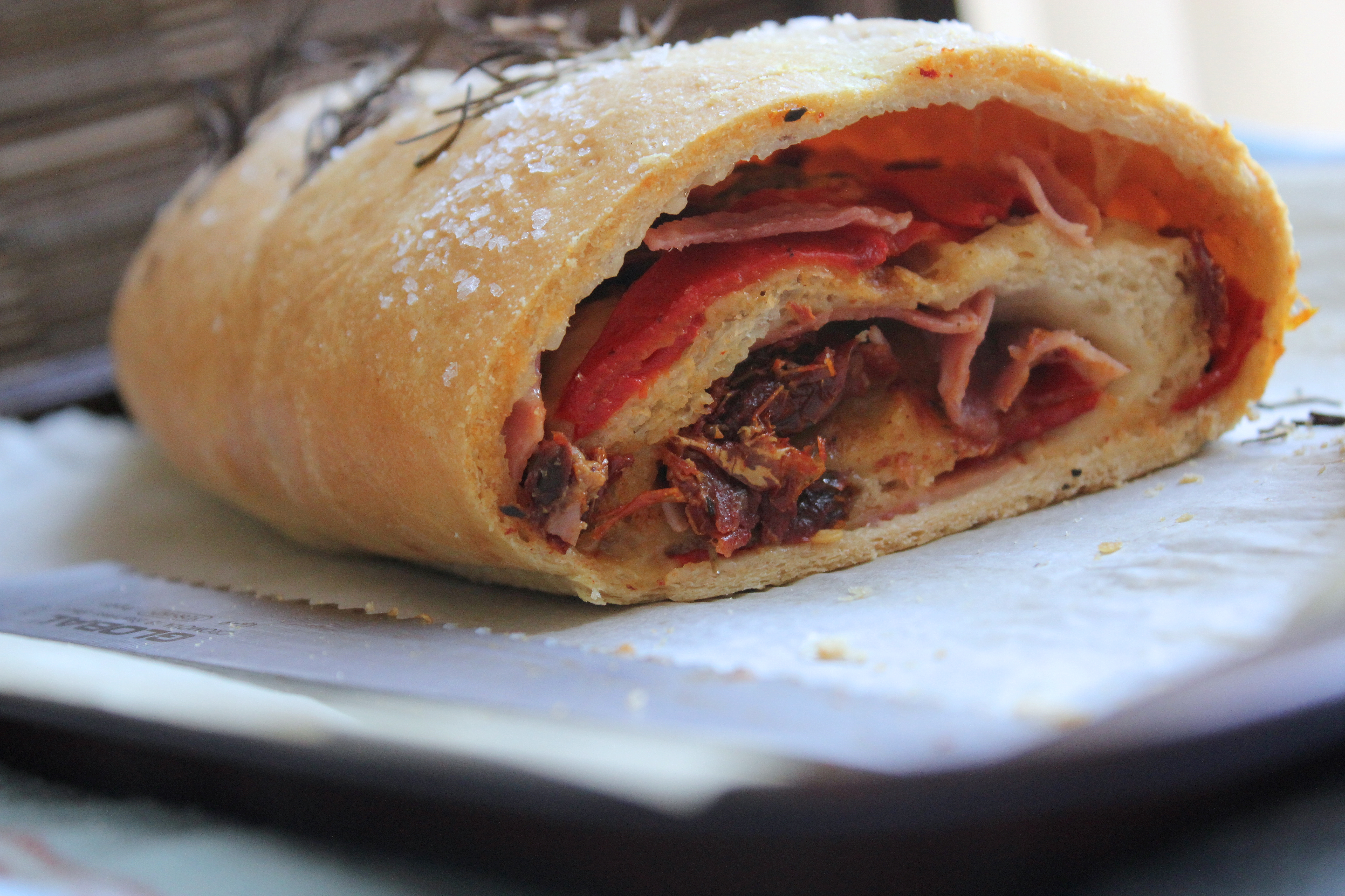 Stromboli with Olives, Sun Dried Tomatoes, Ham, Salami
